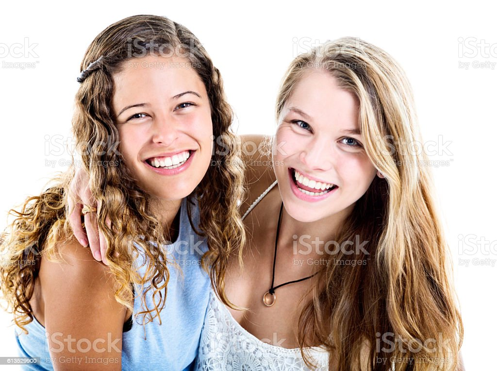 Two young beauties give beaming smiles stok fotoğrafı
