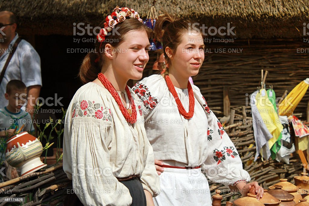 Two young beautiful girls in outdoor ethnic village Pirogovo, Kiev stock photo