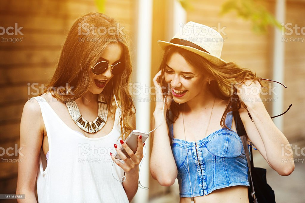 Two young beautiful girls stock photo