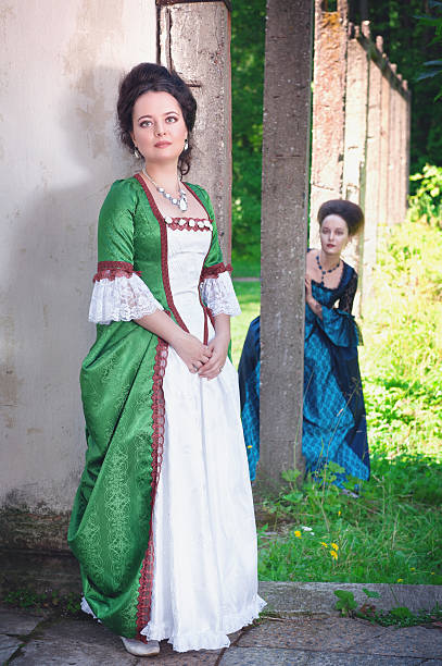 two young beautiful women in long medieval dresses - petticoat stock pictures, royalty-free photos & images