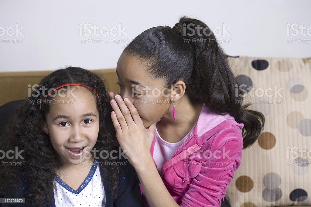 Two young biracial Hispanic Girls sharing Secrets royalty-free stock photo