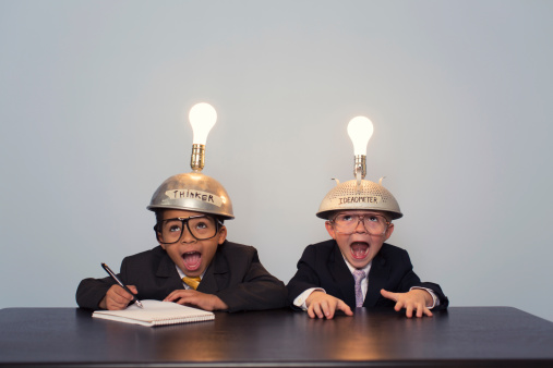 istock Two Young Boy Dressed in Suits and Thinking Caps 477773181