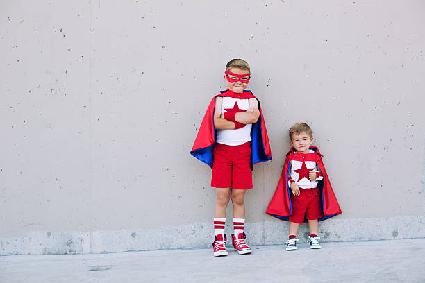 two young boy superheroes imagine taking off - baby super hero imagens e fotografias de stock