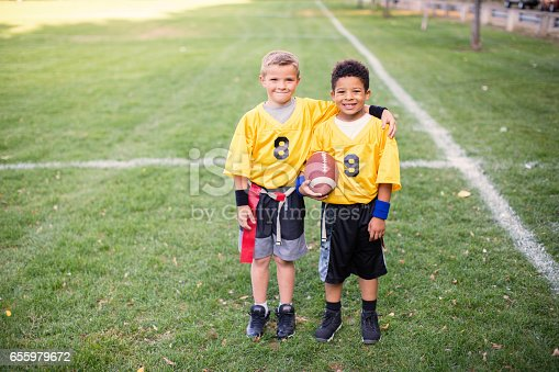 istock Two Young Boys and Teammates Play Flag Football 655979672