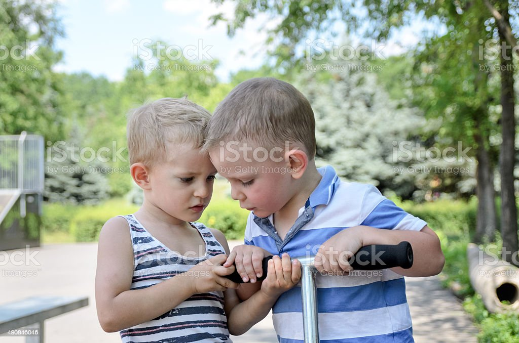 Two young boys arguing stock photo
