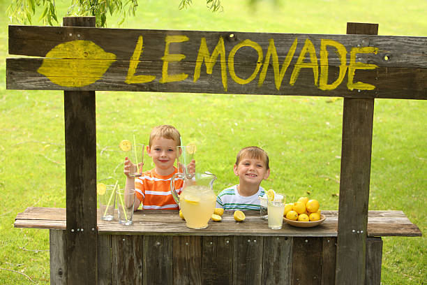 Two young boys at lemonade stand  lemonade stand stock pictures, royalty-free photos & images