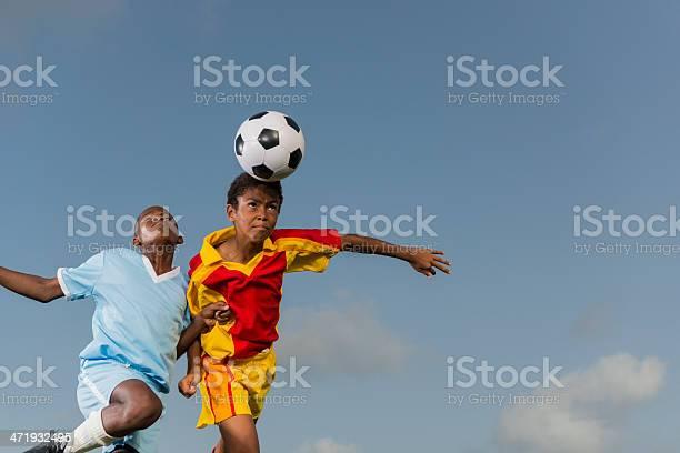 Two young boys playing football picture id471932495?b=1&k=6&m=471932495&s=612x612&h=xufnidrgnggek7hpoa8 y4icegoijbu9keej2veyaua=