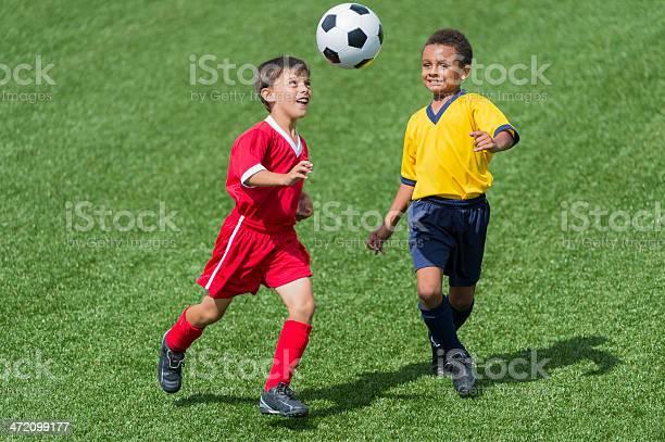 Two young boys playing football picture id472099177?b=1&k=6&m=472099177&s=612x612&h=dm6 pbnmjr4cmyllhzp nmba7a4ii3ihpqqiyqjbteu=