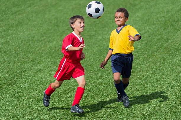 Two young boys playing football picture id472099177?b=1&k=6&m=472099177&s=612x612&w=0&h=dklhm46sobunnyk4mfdcdn7er6gq3obp j8xdtkrdqk=