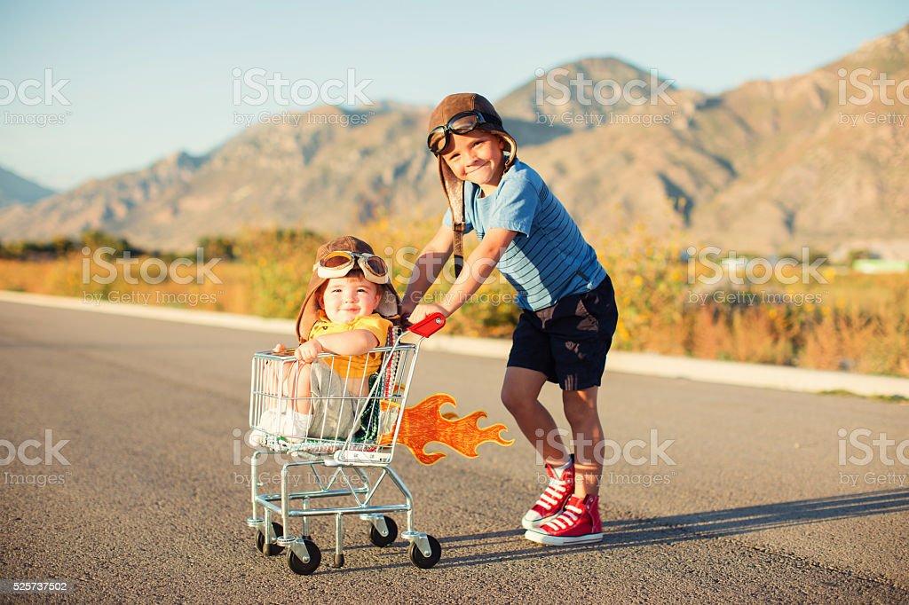 Two Young Boys Racing Shopping Cart stock photo
