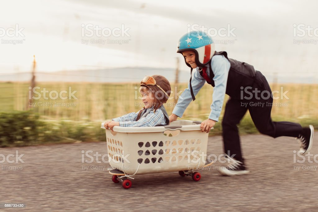 Two Young Business Boys Racing on Skateboard stock photo