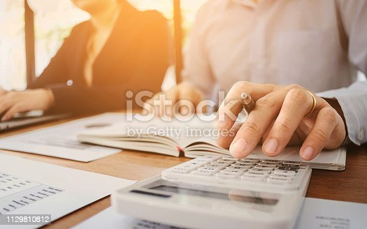 two young business partner consultant working on data resource valuation investment