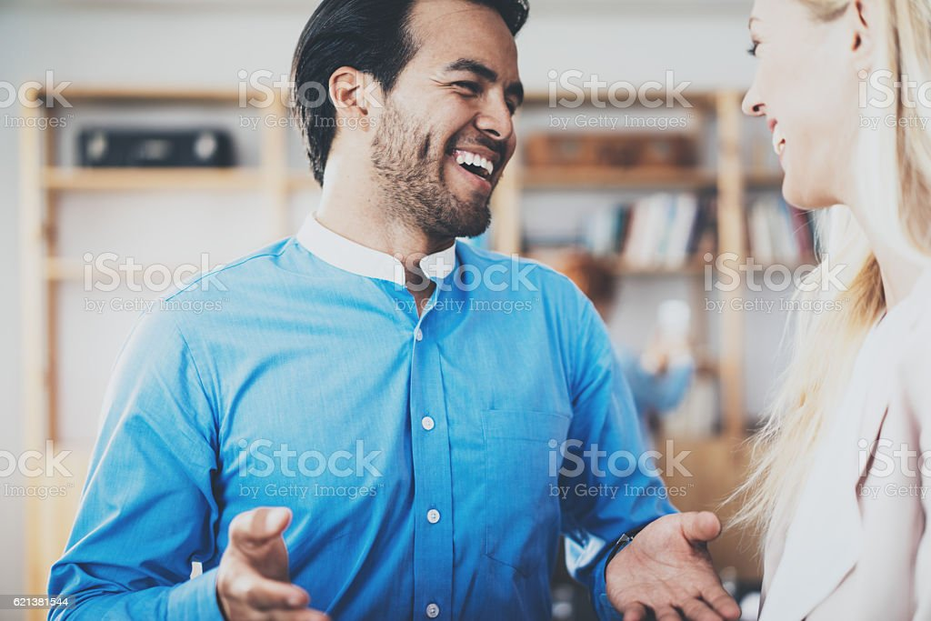 Two young business partner smiling after great discussion in modern stock photo