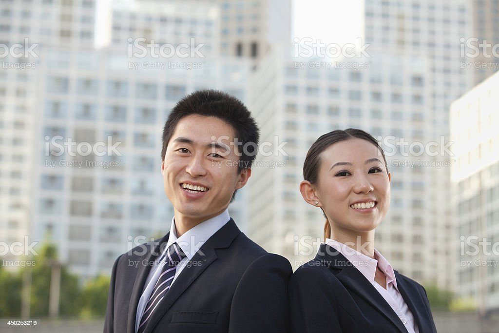 Two young business people outside stock photo