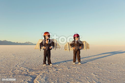 istock Two Young Businessman Wearing Jet Packs 844638696