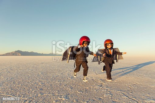 844638658 istock photo Two Young Businessman Wearing Jet Packs 844638712