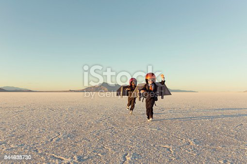 844638658 istock photo Two Young Businessman Wearing Jet Packs 844638730