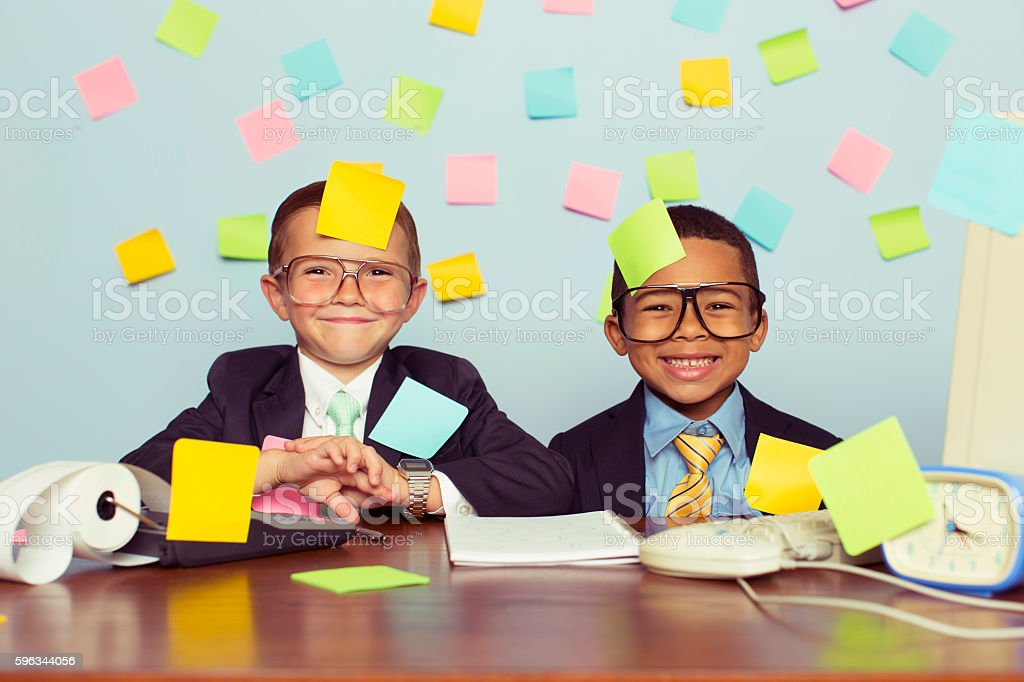 Two Young Businessmen at Desk Covered with Blank Sticky Notes stock photo