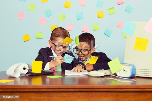 istock Two Young Businessmen at Desk Covered with Sticky Notes 596344072