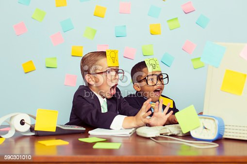 istock Two Young Businessmen Covered with Light Bulb Sticky Notes 590301010