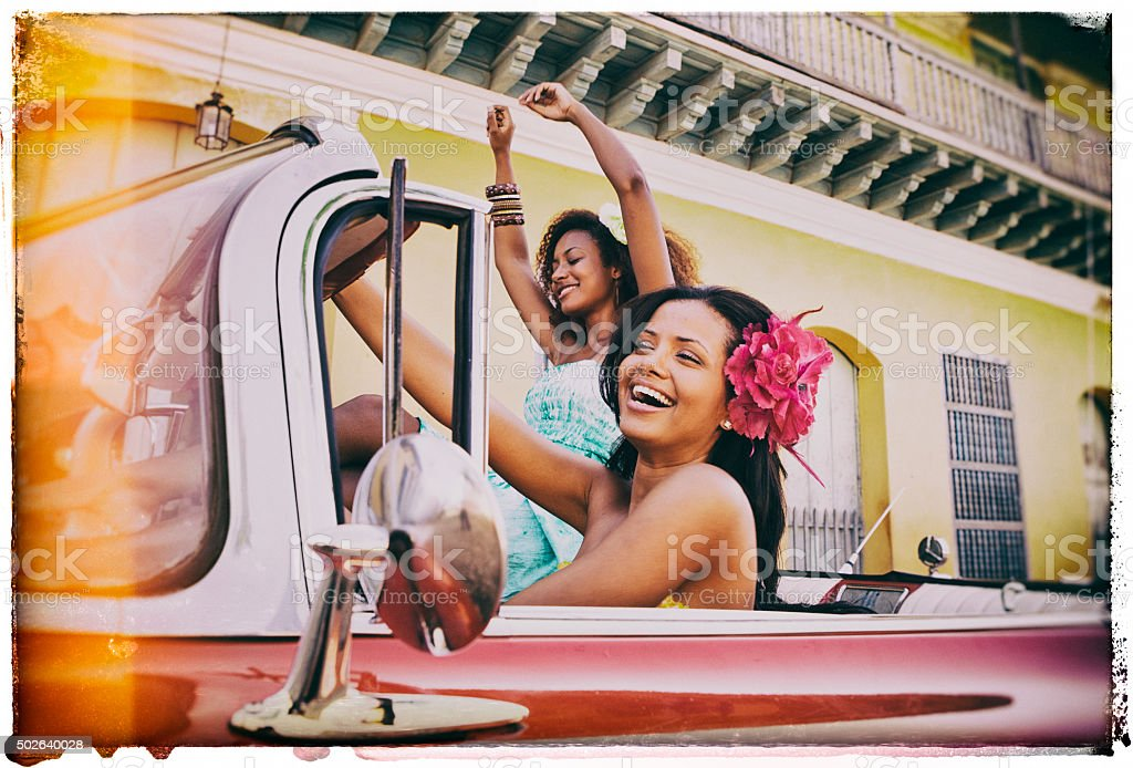 Two Young Caribbean Woman Traveling in Cuba stock photo