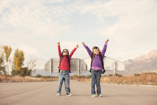 A young boy and girl are ready to take their ideas to the skies. Imagination has no limits.
