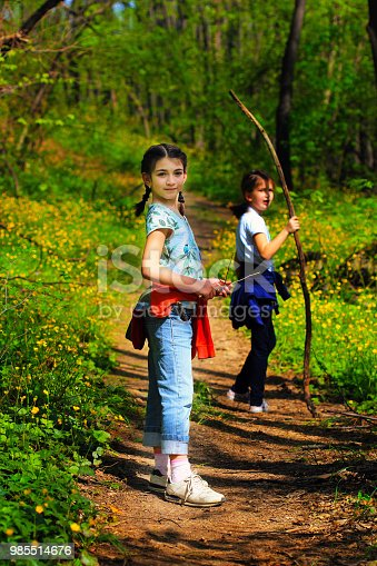 istock Two young children, girls walking through the woods 985514676