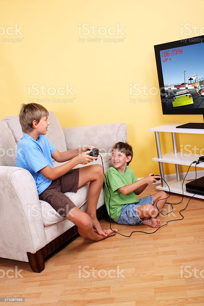 Two young children playing video games royalty-free stock photo