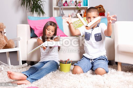 istock Two young children throwing the books away 517149753