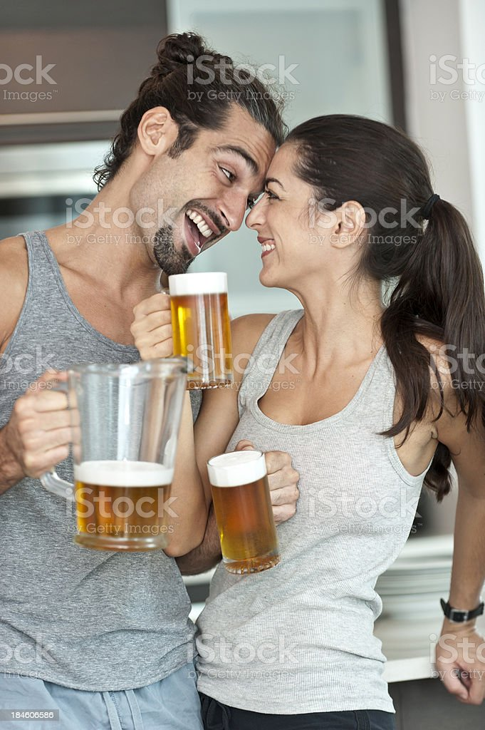 Two young couple having a beer stock photo