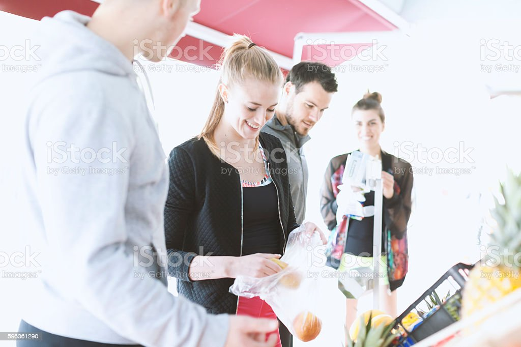 Two Young Couples at  Market Buying Healthy Food royalty-free stock photo