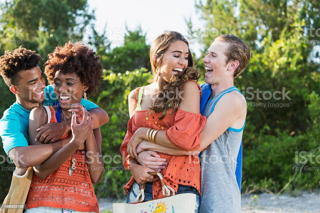 Two young couples having fun on summer day stock photo