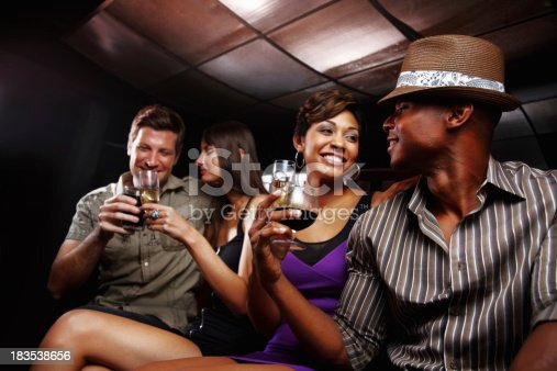 istock Two young couples with drinks, having fun at a nightclub 183538656