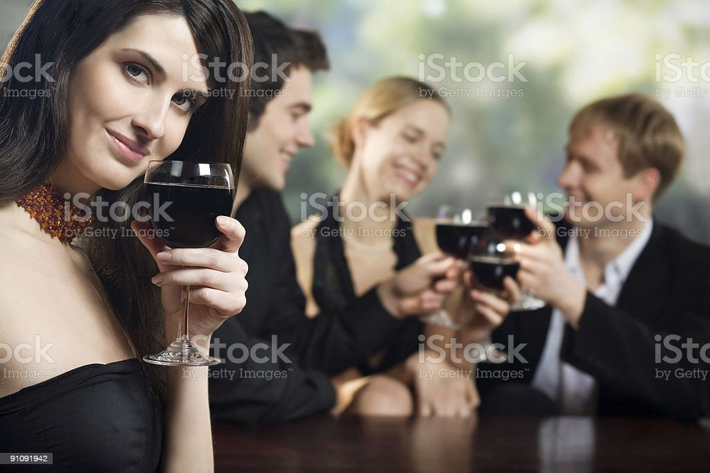 Two young couples with redwine glasses at celebration or party stock photo