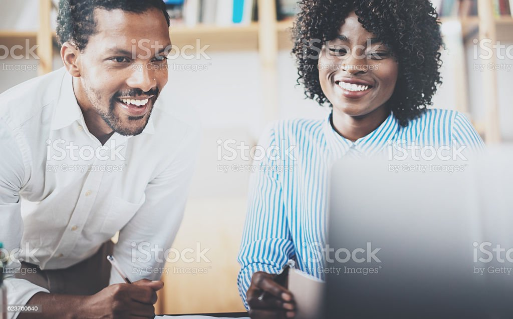 Two young coworkers working together in a modern coworking studio stock photo