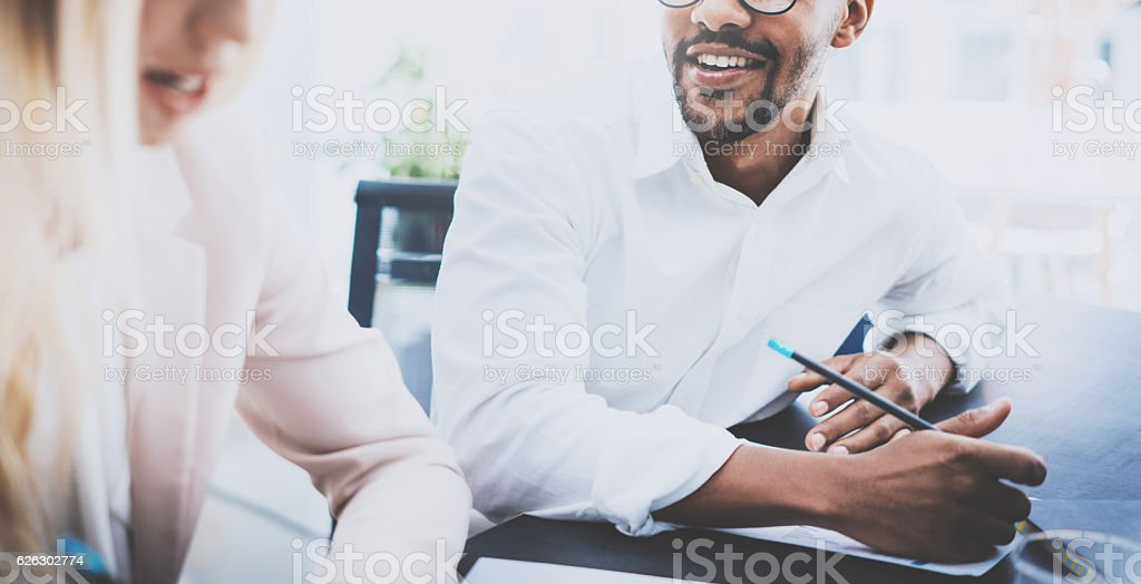 Two young coworkers working together in modern business project.Man stock photo