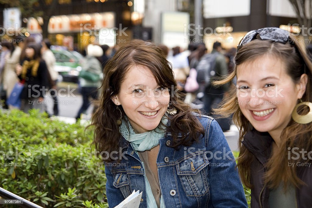 Two young cute women chating royalty-free stock photo