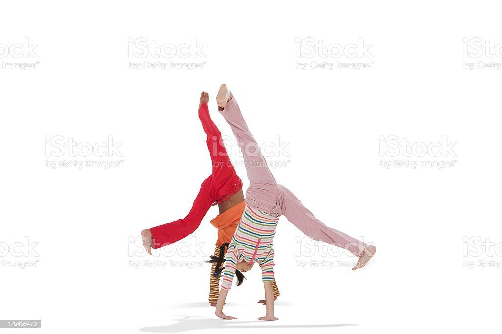 Two young doing cartwheels stock photo
