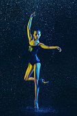 istock Two young female ballet dancers under water drops 1146479207