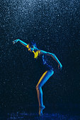 istock Two young female ballet dancers under water drops 1146479584