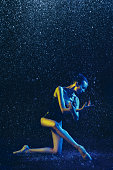 istock Two young female ballet dancers under water drops 1146479652