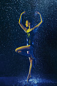 istock Two young female ballet dancers under water drops 1146479690