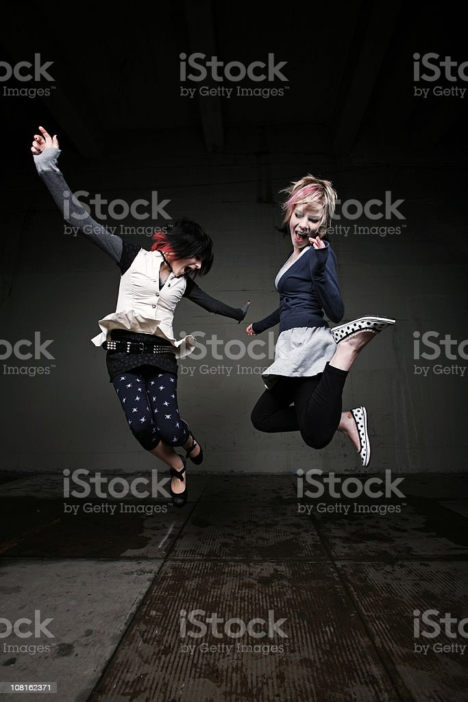 Two Young Females Jumping Portaits royalty-free stock photo