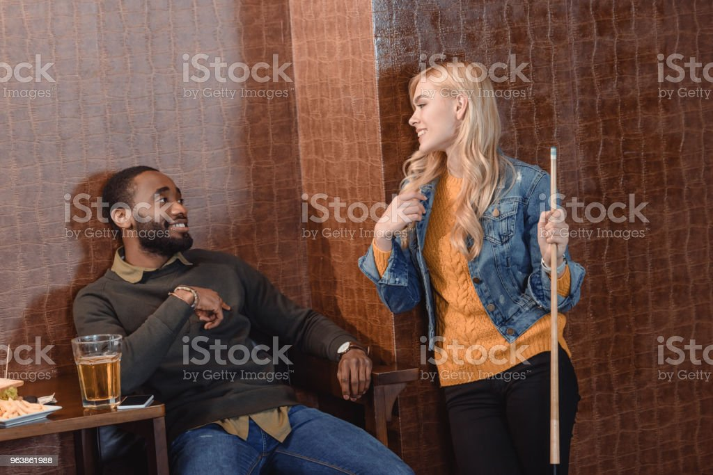 two young friends at pub with beer and food - Royalty-free Adult Stock Photo