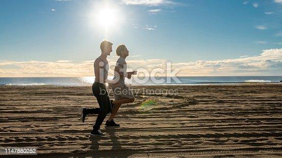 Two young friends jogging at the Venice Beach, Santa Monica, California, USA
