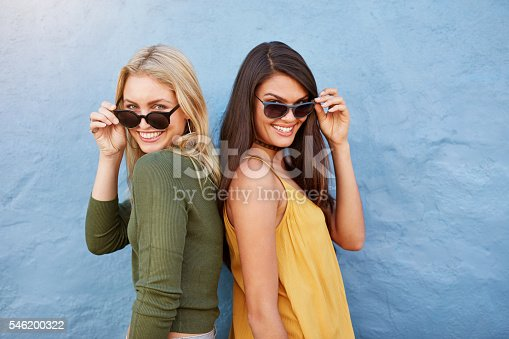istock Two young girl friends in sunglasses having fun 546200322