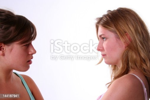 istock two young girls angry (faces) 144187941