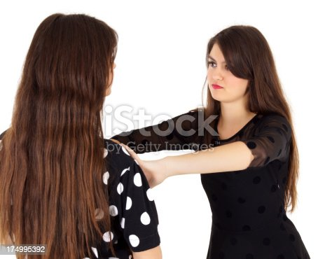 istock two young girls angry 174995392