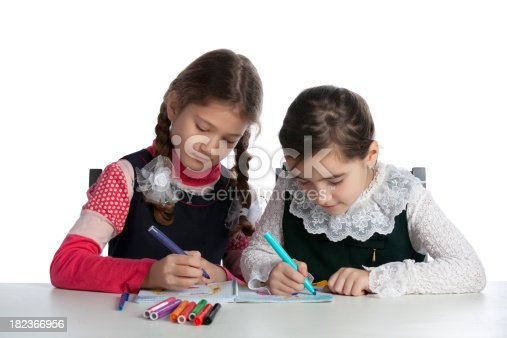 istock Two young girls drawing together 182366956