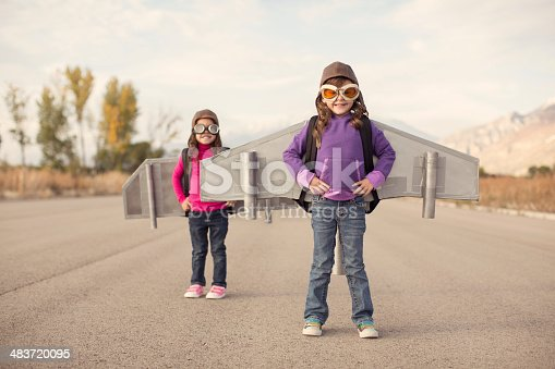 istock Two young girls dressed as pilots wearing jet packs 483720095